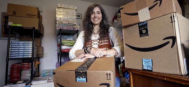 Adrienne Kosewicz, owner of Play It Safe World Toys, poses in April 2018 for a portrait in her home office in Seattle. Kosewicz pays $3,600 a year for tax collection software to handle payments and reports to her home state, Washington.