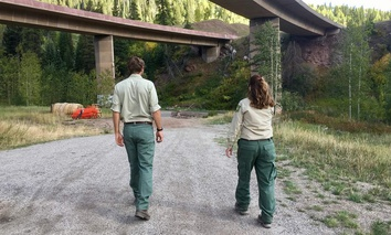 Michael Beach, wilderness and trails manager for the U.S. Forest Service Eagle-Holy Cross Ranger District, and Marcia Gilles, deputy district ranger, walk toward a meadow on the outskirts of Vail that's been a hotspot for illegal camping in the past.