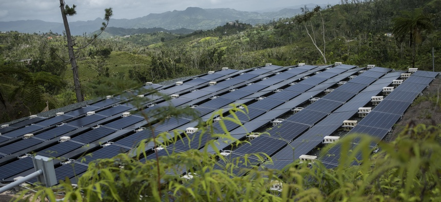 In this July 20 photo, solar panels installed by Tesla, power a community of 12 homes in the mountain town of Las Piedras, Puerto Rico. Las Piedras still doesn't have power off the national grid, more than 10 months after Hurricane Maria.
