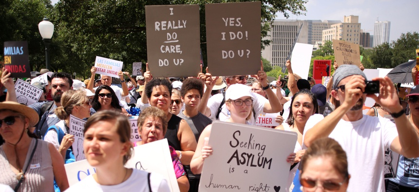 Demonstrators protest on June 30, 2018 at an anti-family separation immigration rally at the state capitol in Austin, Texas.