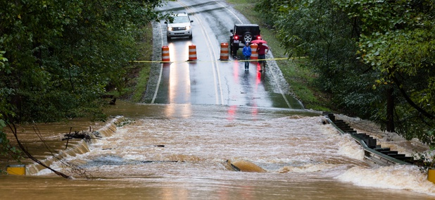 Waxhaw, North Carolina - September 16, 2018: Motorists inspect a road flooded by rain from Hurricane Florence.