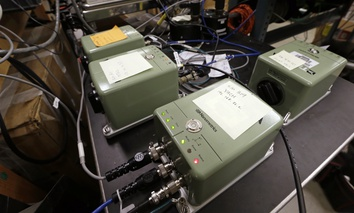 In this photo taken Thursday, Aug. 6, 2015, earthquake monitors that will be placed on the Oregon and Washington coasts sit on a table at the Pacific Northwest Seismic Network at the University of Washington, where they are prepared for installation.