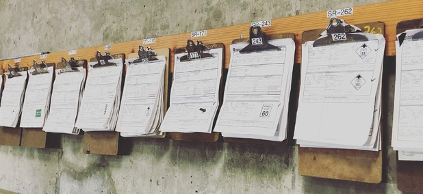 Clipboards with paper inspection sheets hang on the wall of a Washington State Department of Transportation maintenance office in 2014. Maintenance field staffers now use iPads and apps to inspect everything from guardrails to drainage systems.