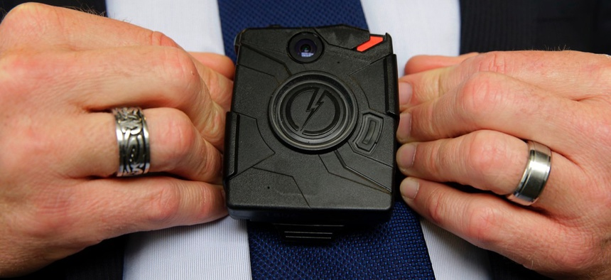 Steve Tuttle, vice president of communications for Taser International, demonstrates one of the company's body cameras during a company-sponsored conference at the California Highway Patrol headquarters in Sacramento.