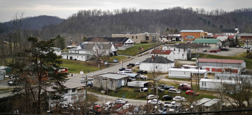 Main Street, center, cuts through Sandy Hook, Ky., a place badly battered by the collapse of the coal industry, Thursday, Dec. 14, 2017.