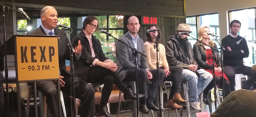 Washington Gov. Jay Inslee, far left, speaks at the KEXP Gathering Space on Tuesday in Seattle.