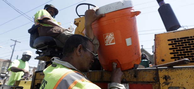City paving crew member William Nater fils a water bottle in the afternoon heat, Friday, July 6, 2012, in Philadelphia.