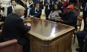 Rapper Kanye West speaks to President Donald Trump and others in the Oval Office of the White House, Thursday, Oct. 11, 2018, in Washington.