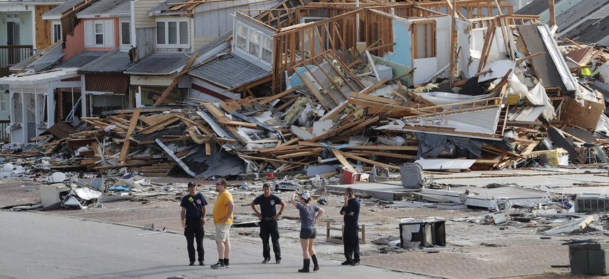 Search and rescue personnel on the ground in Mexico Beach, Florida following Hurricane Michael.