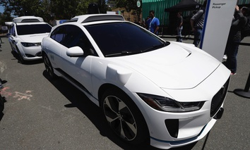 Waymo cars are displayed at the Google I/O conference in Mountain View, California, on May 8.