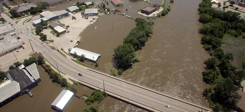 A swollen Iowa River flows under the Benton Street bridge in Iowa City, Iowa, on Monday, June 16, 2008.