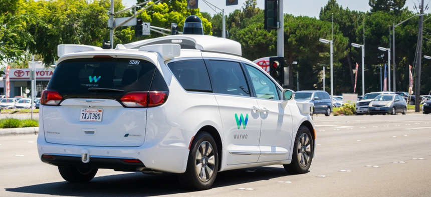 Waymo self-driving car cruising on a street in Silicon Valley in 2017.