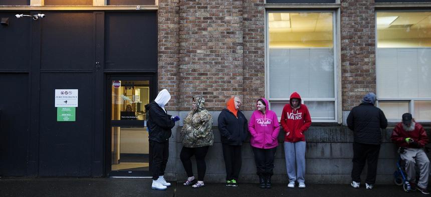 People wait in line outside a Washington state methadone clinic in 2017.