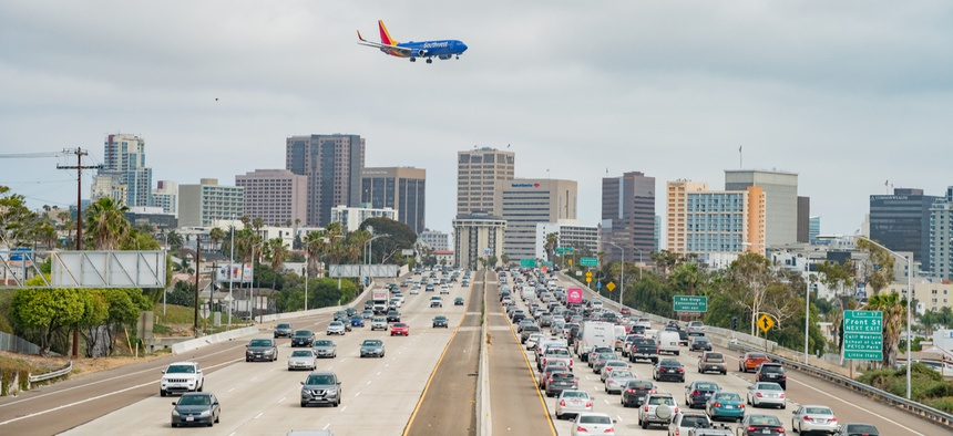 A plane prepares to land at San Diego International Airport near downtown San Diego.