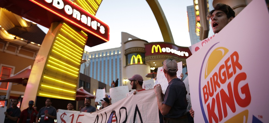 In this Sept. 4, 2014 file photo, protestors, including Kris Varrette, right, chant for increased wages and union rights at fast food restaurants in Las Vegas.