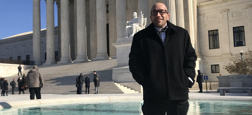 Tyson Timbs poses for a photo outside the U.S. Supreme Court on Nov. 28, 2018.