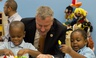 In this Sept. 4, 2014 file photo, New York Mayor Bill de Blasio visits a pre-K program in Brooklyn on the first day of the mayor's ambitious expansion of early childhood education.