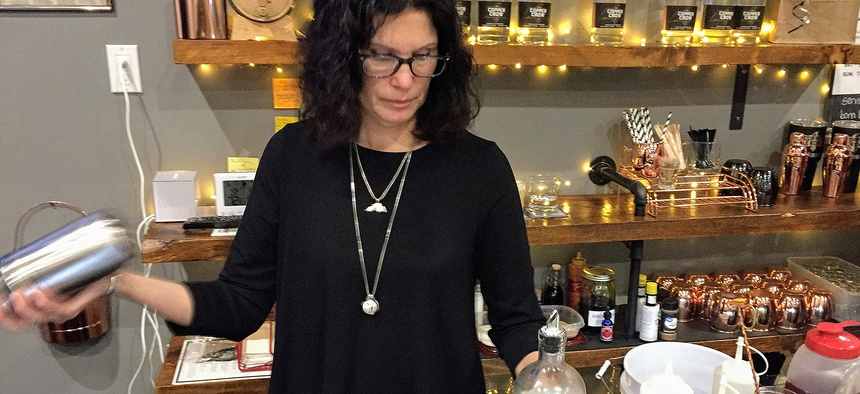 Linda Basina, a co-owner of the Copper Crow Distillery, mixes one of the Wisconsin distillery's signature cocktails. Copper Crow is the first distillery owned by Native Americans.