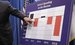 In this May 13, 2016, file photo, California Gov. Jerry Brown gestures to a chart showing possible future deficit spending as he discusses his revised 2016-17 state budget plan in Sacramento, Calif.