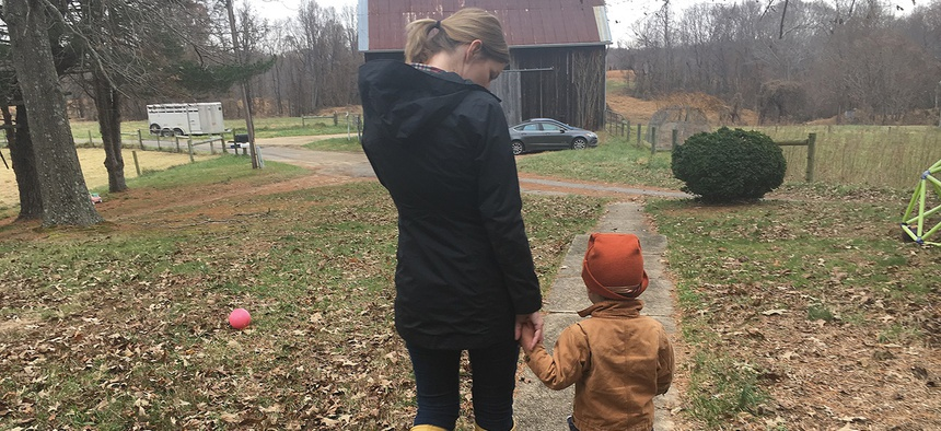 Jamie Tiralla, 36, walks with her 3-year-old son, Isaac, on the family's farm in Prince Frederick, Maryland. Tiralla and her husband are young farmers managing a 115-acre farm that has been in his family for nearly a century.
