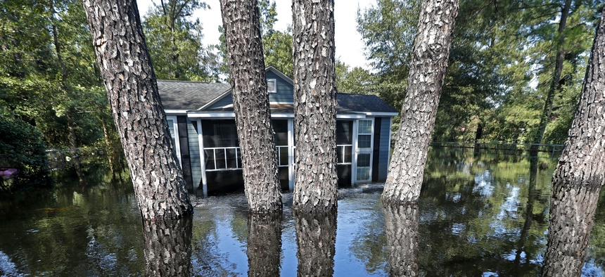 A house and pine trees are seen in South Carolina floodwaters in the aftermath of Hurricane Florence on Sept. 21, 2018.