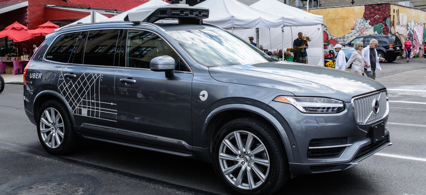 An Uber autonomous driving car, with back-up human driver aboard in Pittsburgh.