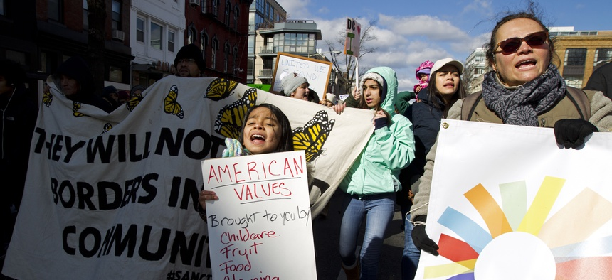 Supporters of immigrants' rights march downtown Washington, D.C., during an immigration protest Thursday, Feb. 16, 2017.