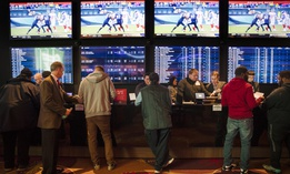 In this Thursday, Dec. 13, 2018, file photo, gamblers place bets in the temporary sports betting area at the SugarHouse Casino in Philadelphia.