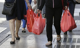 In this Sept. 20, 2016, file photo, women walk with plastic bags through Chinatown in San Francisco. California was the first state to enact a staetwide ban on plastic bags.