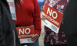 People protest the partial government shutdown in downtown Denver on Thursday, Jan. 10, 2019.