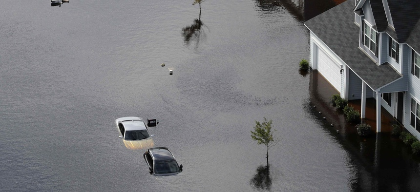 Cars are submerged in a neighborhood in the aftermath of Hurricane Florence in Fayetteville, N.C., Monday, Sept. 17, 2018.