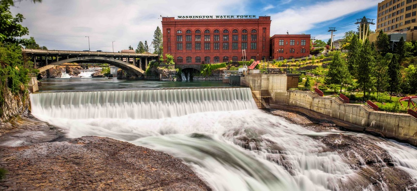 Falls and the Washington Water Power building along the Spokane river in Spokane, Washington.
