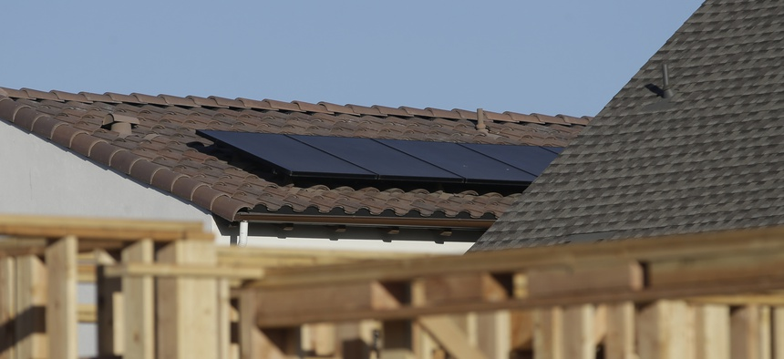 Solar panels are installed on the rooftop of a home in a new housing project in Sacramento, California.