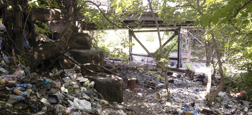 This July 31, 2017, file photo shows trash including discarded syringes and other rubbish in an open-air heroin market that has thrived for decades, slated for cleanup along train tracks a few miles outside the heart of Philadelphia.