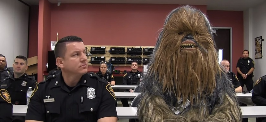 Fort Worth Police Officer Jimmy Pollozani gets ready to make the rounds with his rookie — make that Wookiee — partner of the day, Chewbacca (Sgt. Trey Gibbs), in a Star Wars-themed recruiting video that has drawn nearly 3 million views on social media.