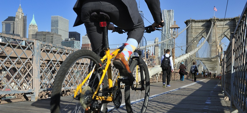 Bike riders commuting to Manhattan over the Brooklyn Bridge.