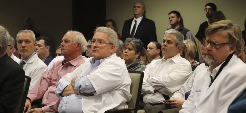 Pharmacists packed a state Capitol hearing room last year in Little Rock, Ark., to complain about low reimbursement rates from pharmacy benefit managers within state managed insurance plans.