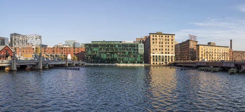 Boston's Seaport District, where General Electric had planned to build a new headquarters building, sits adjacent to Fort Point Channel.