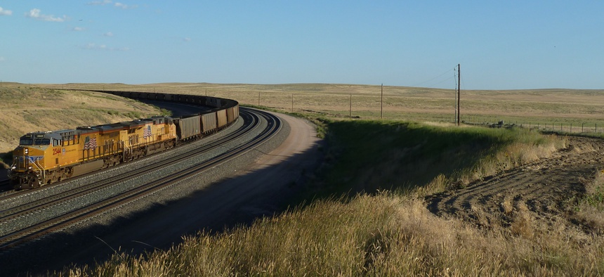 Locomotives and coal train rounding a track curve in Powder River Basin of Wyoming.
