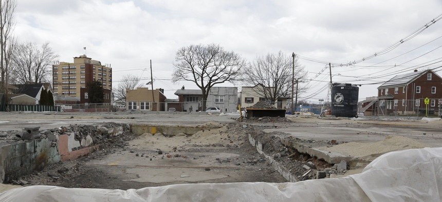 In this March 22, 2013 photo, a superfund site is seen empty behind a fence, in Garfield, N.J.