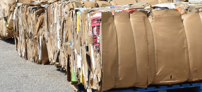 Large bundles of compressed cardboard await pickup in Greenville, South Carolina in April 2018.
