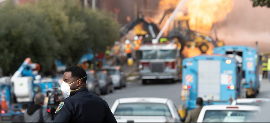 Firefighters battle a gas main blaze on Geary Blvd. in San Francisco's Richmond District in February.