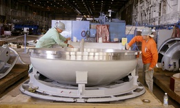 A missile hatch for a Virginia class nuclear powered submarine is worked on by Electric Boat employees in July 2014 at the company's Quonset Point facility, in North Kingstown, R.I.