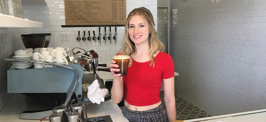 Anna Buck, a barista, holds a cup of CBD-infused cold brew at Blue Sparrow Coffee in Denver. Federal regulators say businesses that add cannabidiol to food are essentially adding prescription drugs into the food supply.
