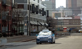 "One of Ford's ""Argo AI"" autonomous vehicles navigates through the strip district near the company offices in Pittsburgh."