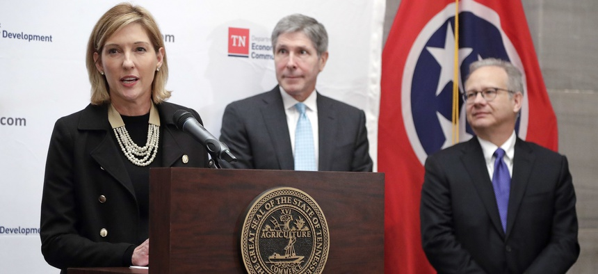 Holly Sullivan, left, of Amazon Public Policy, talks about a decision by Amazon to locate an operations hub in Nashville , Tenn. With Sullivan are Economic and Community Development Commissioner Bob Rolfe, center, and Nashville Mayor David Briley, right