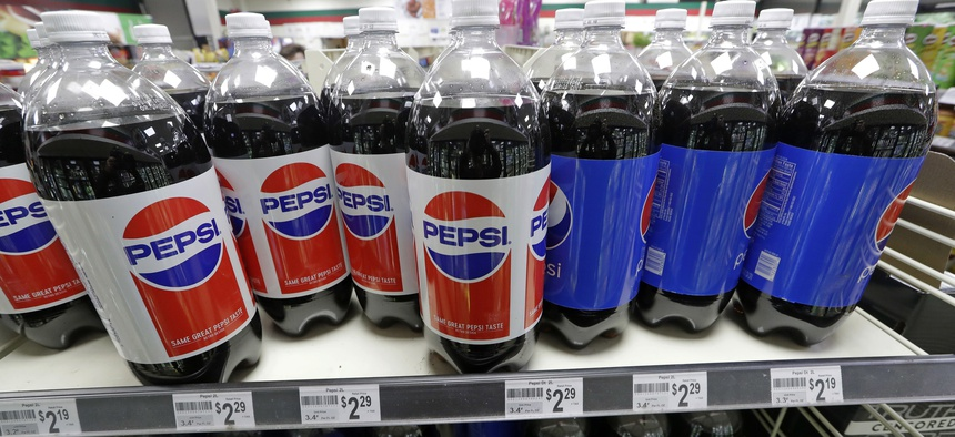 Pepsi products fill shelves in a convenience store in Kent, Wash. Voters in the state last year approved a measure to block local taxes on Soda.