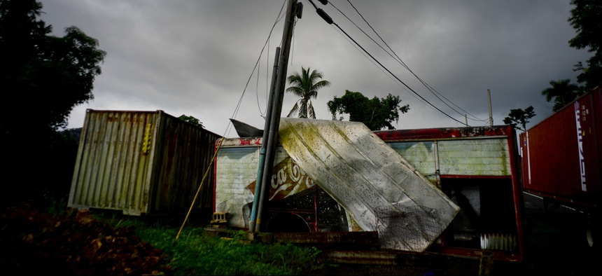 In this Sept. 7, 2018 photo, a Coca-Cola trailer destroyed a year before by Hurricane Maria stands on the side of the road in Orocovis, Puerto Rico.