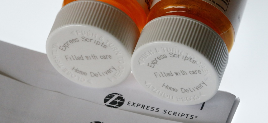 Express Scripts prescription medication bottles are arranged for a photo.