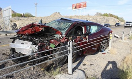 A smashed up vehicle sits on the shoulder of Interstate 80 in West Wendover, Nevada, following a crash that claimed at least two lives, in which one vehicle was traveling the wrong direction on the highway.